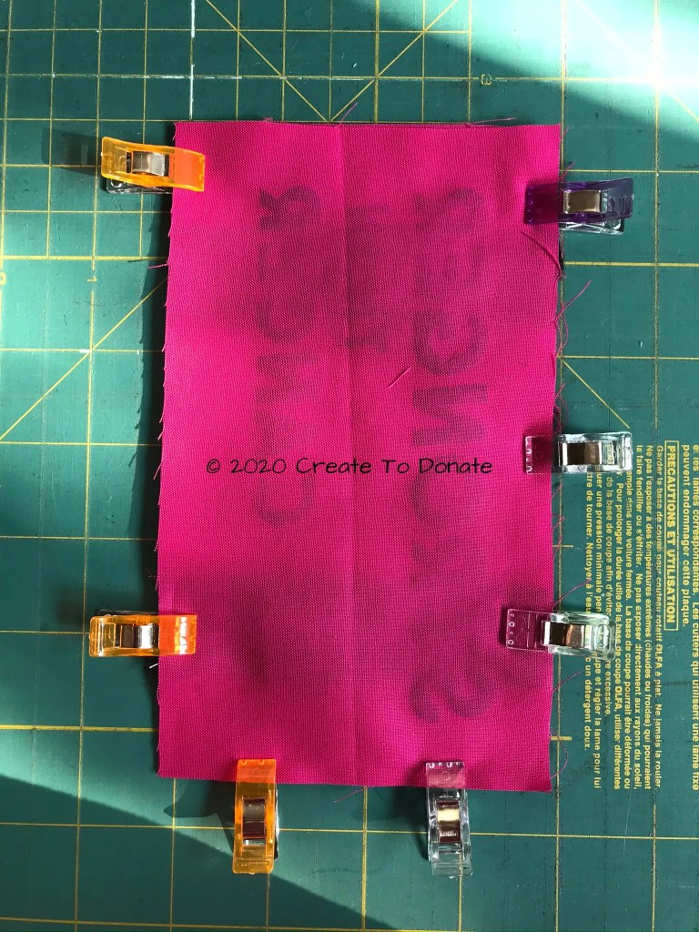 Prepare the portacath pillow for sewing with clips