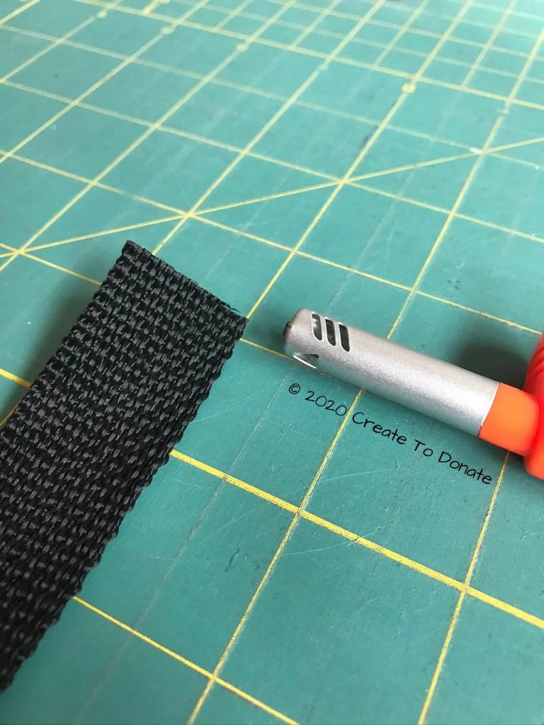 Singe edges of nylon webbing