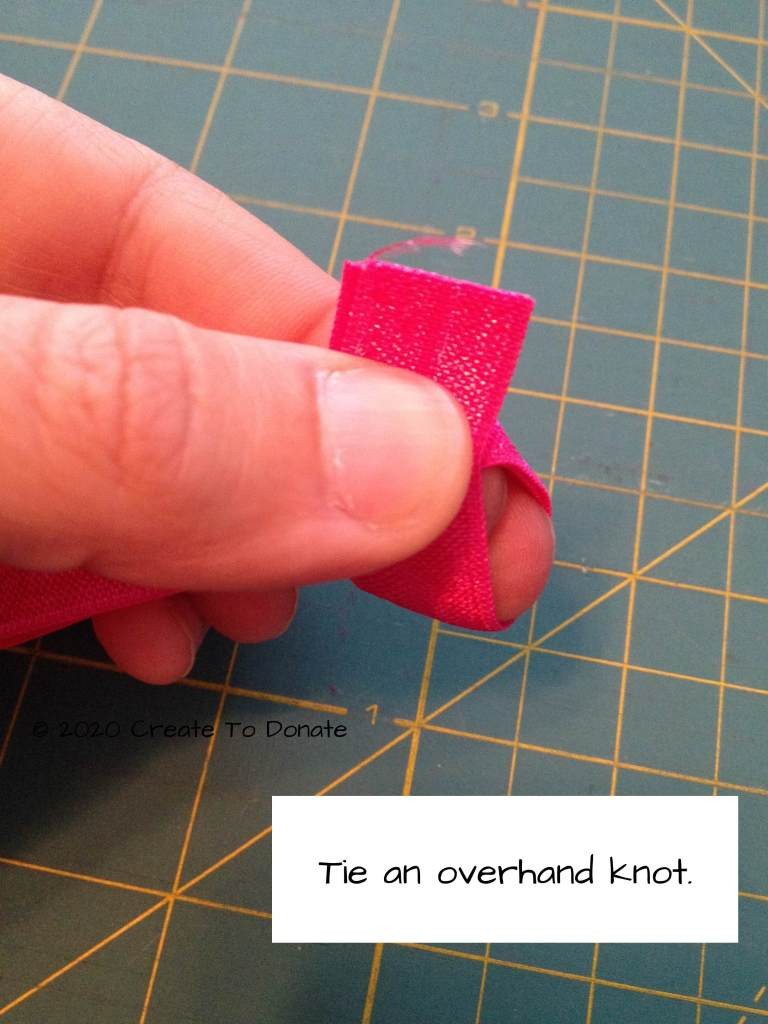 Tie an overhand knot for hair tie