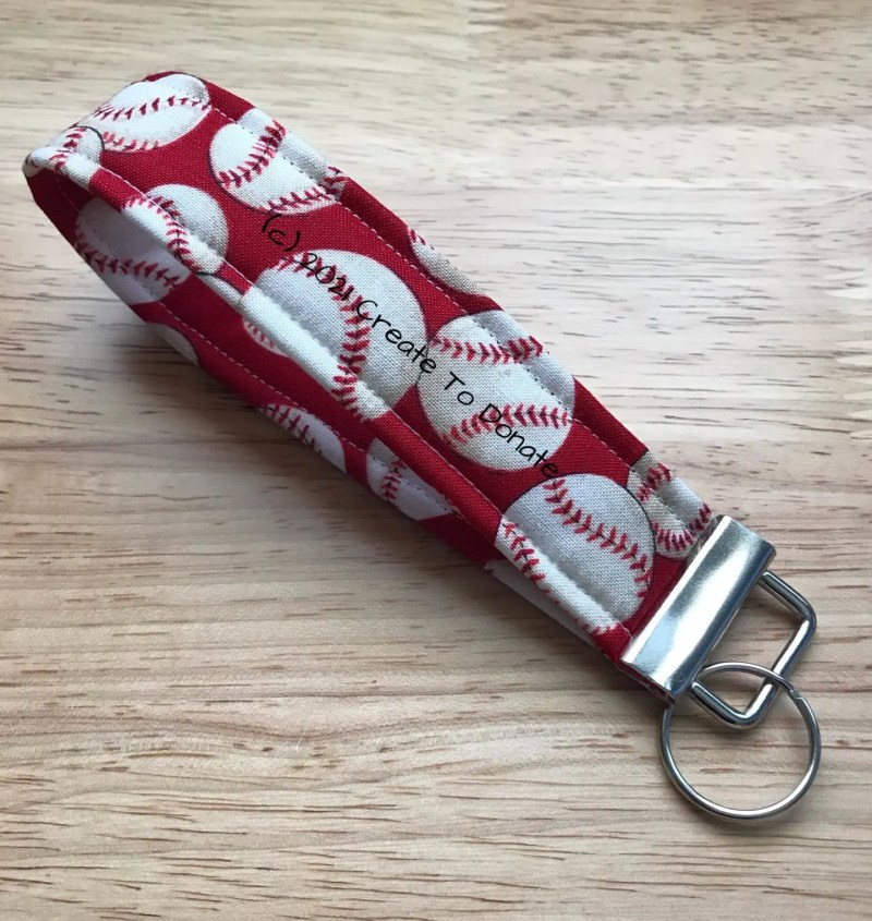Key fob from fabric with baseball on a red background for a silent auction basket with baseball theme.