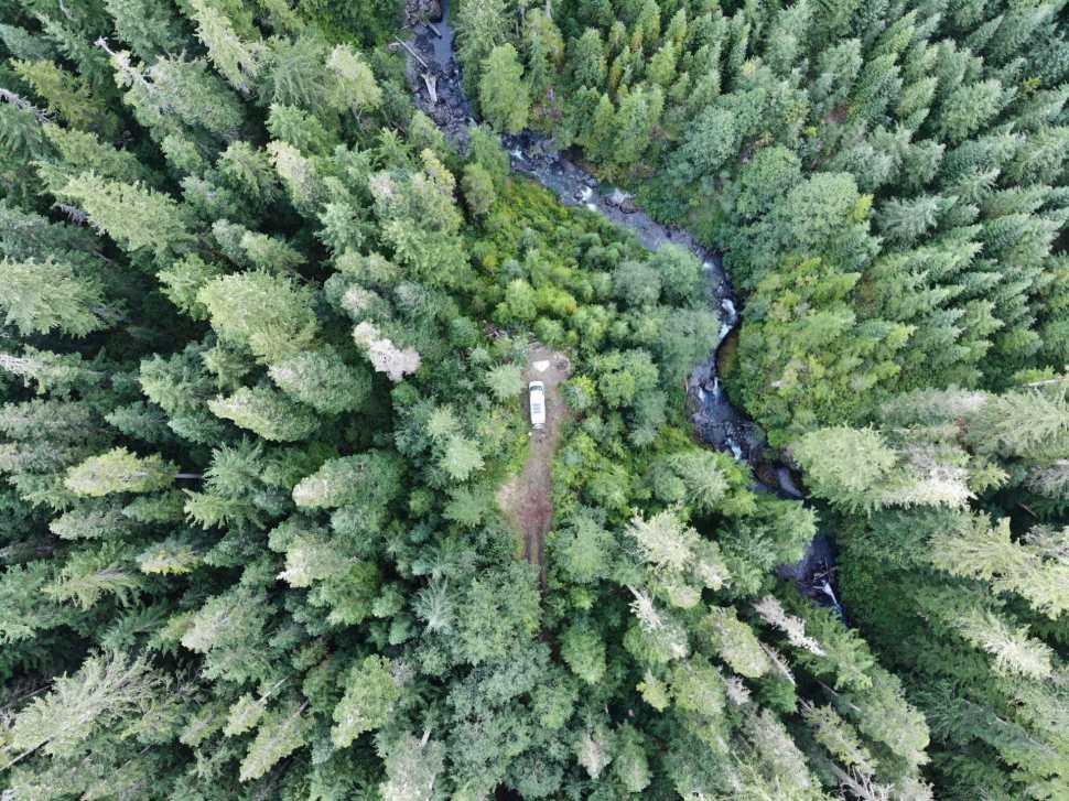 Aerial photo of campervan in the woods
