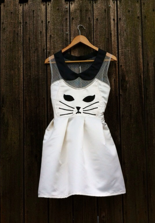 This kitty cat dress from ChurchCampShop is way too adorable!