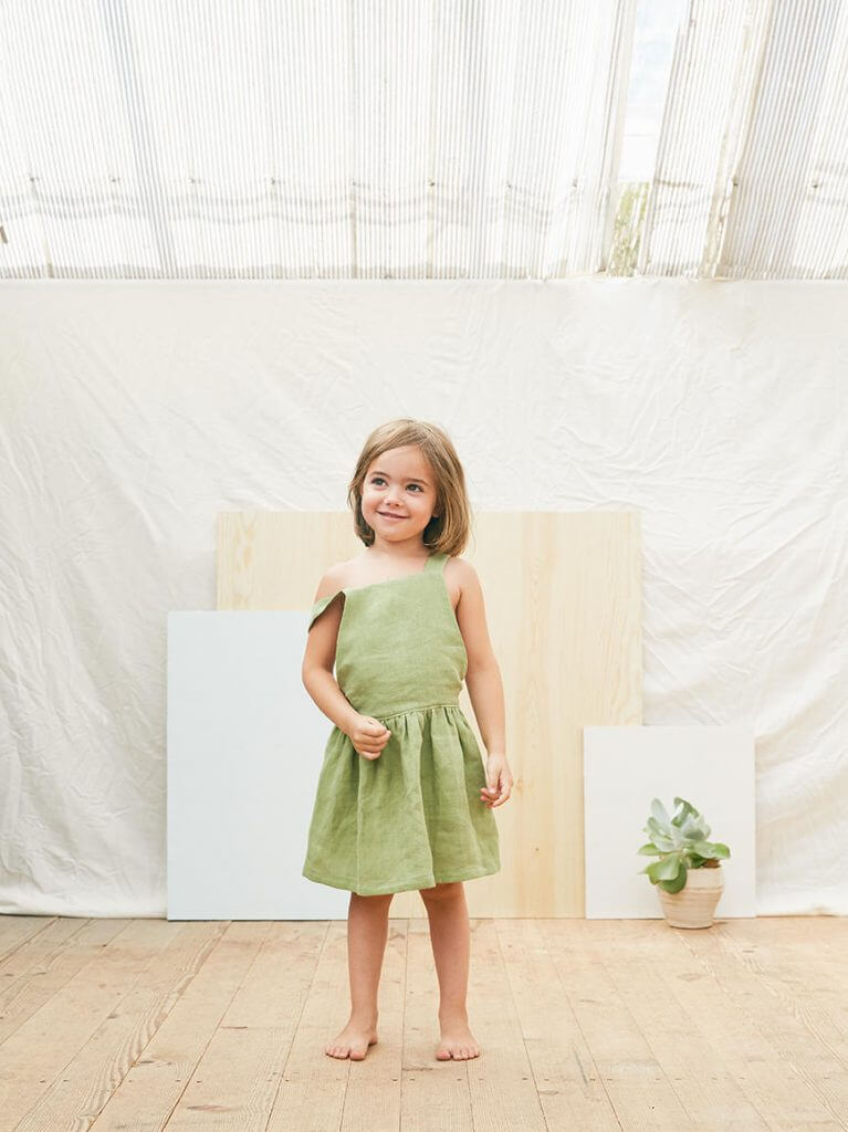 How to Take Better Photos for Your Etsy Shop | Use models when you can, like this little girl in her dress from matonastudio!