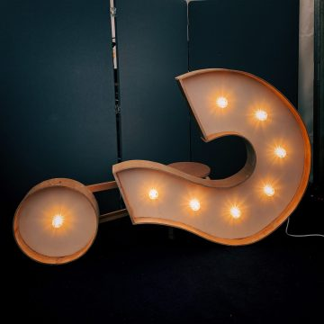 White question mark in lights in article by Sussex wedding celebrant Claire Bradford of Creating Ceremony