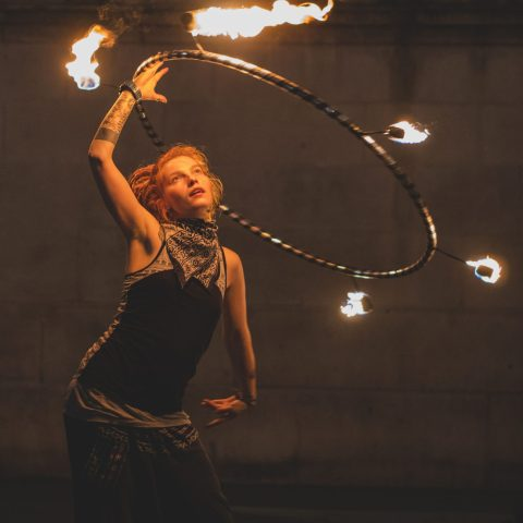 Girl juggling with a hula hoop on fire in article by Sussex wedding celebrant Claire Bradford of Creating Ceremony