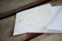 White Cardstock with Gold Glitter Embossing: Will You Marry Us?