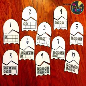 halloween math puzzles for counting on a table