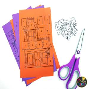 halloween whole class math facts with papers and cards and scissors