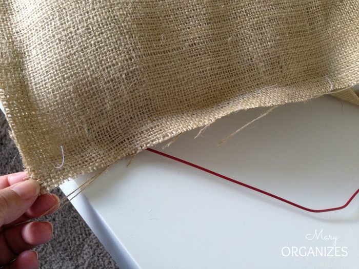Sew the 4th edge together with the hanger in place