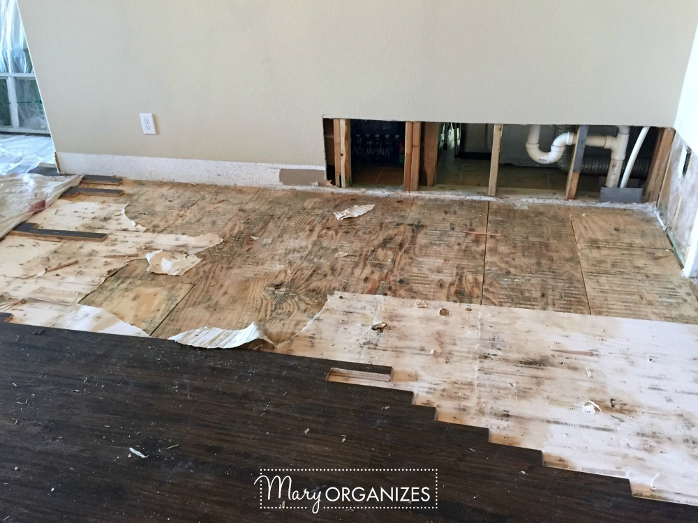 renovation-phase-2-wall-repair-wood-floor-start-and-tile-1