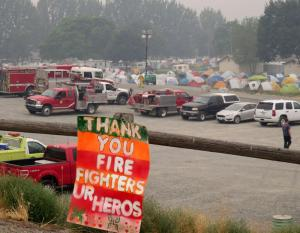 The smoky Okanogan Complex fire camp has taken over the county fairgrounds.Tom Banse Northwest News Network