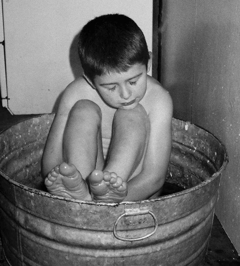 The boys sometime fell asleep in the tin tub, warmed by the wood stove.