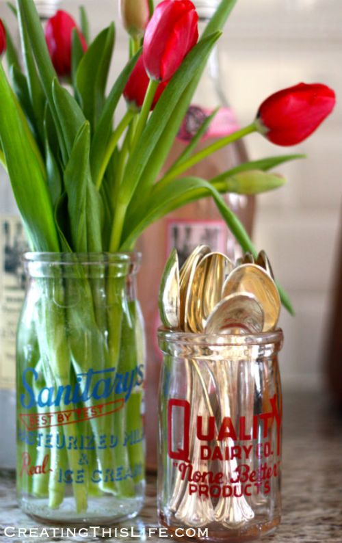 vintage dairy jars with flowers and spoons