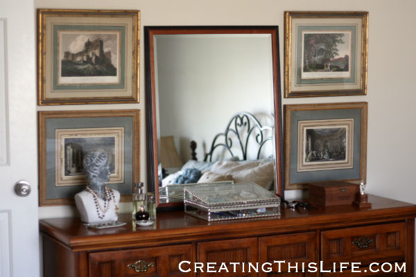 Master bedroom dresser with estate sale framed prints