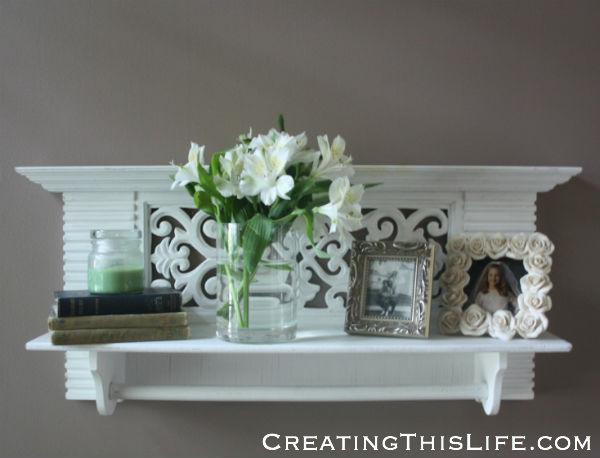 white-shelf-flowers-books-pictures-arrangement