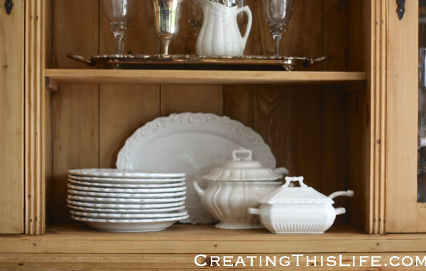 White dishes in pine hutch at CreatingThisLife.com
