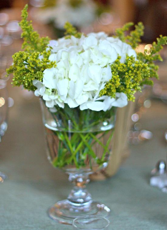 white hydrangea arrangement in clear vase