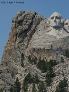 Notice the bent and cracked rocks by the presidents' faces at Rushmore. Notice the little white streak on the right side of Washington's forehead
