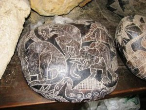 Ica stone depicting dinosaurs