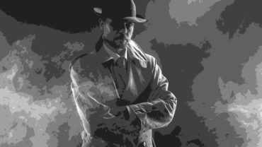 mysterious-man-waiting-with-arms-crossed-in-the-fog-1950s-style-film-noir