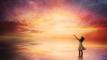 woman-stands-in-praise-before-a-beautiful-night-sky