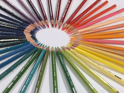 Photograph of a rainbow of colored pencils