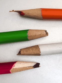 Photo of Example of soft, wax based colored pencils that were not sharpened properly