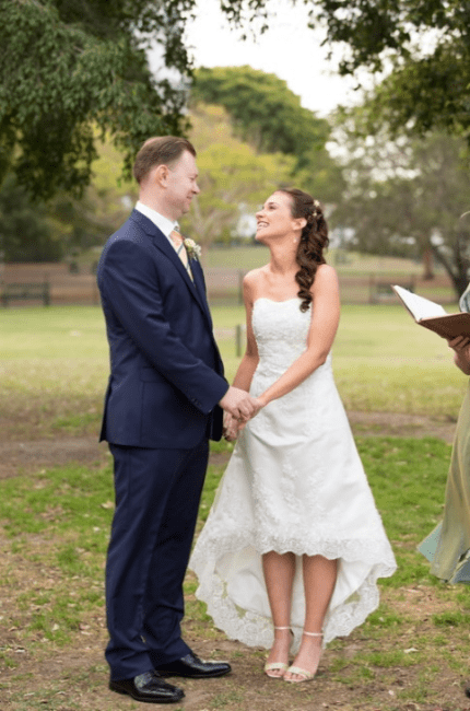Groom and bride under tree at Brisbane Powerhouse wedding venue during marriage ceremony