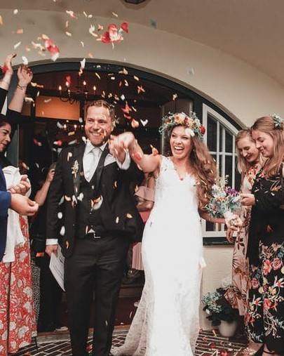 A rose petal toss is a fun way to end the wedding ceremony