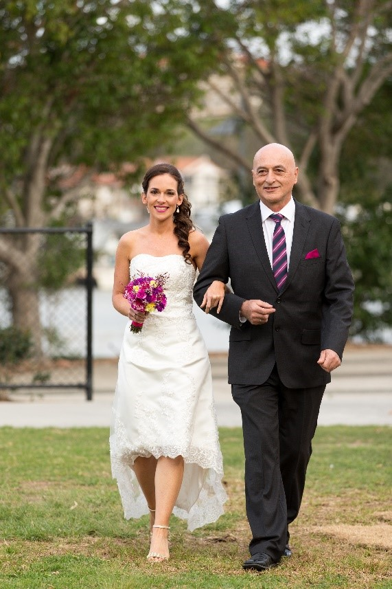 Father walks bride down the aisle in online bought high lo wedding dress