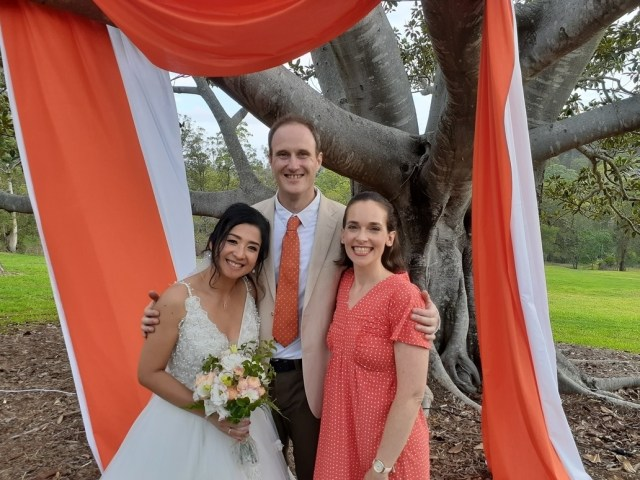 Brisbane celebrant with bride and groom under fig tree for outdoor marriage ceremony