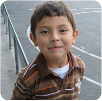 Young boy in brown shirt