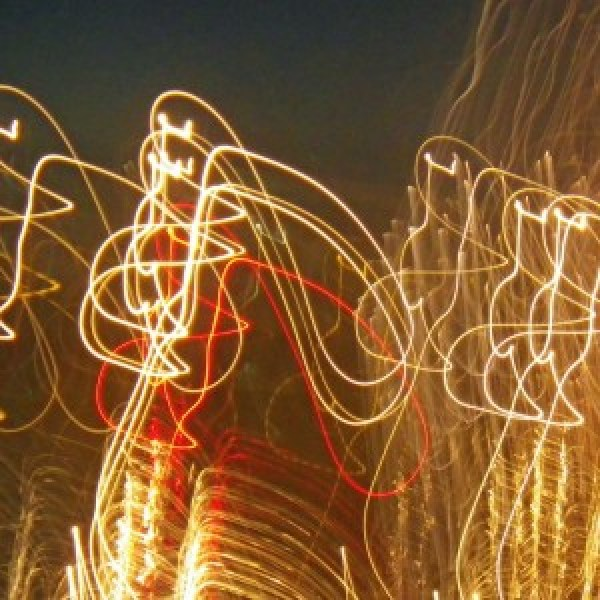 Light painting of fireworks over English Bay.