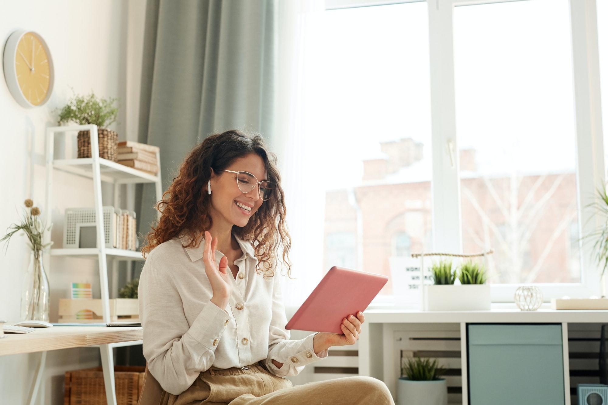 Businesswoman Speaking During Online Meeting