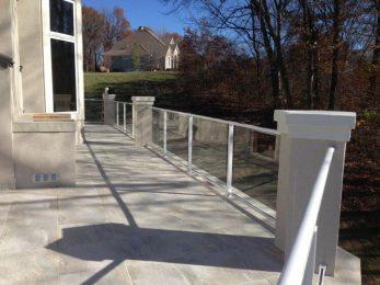 Tile deck, composite sub-floor, stucco columns, glass handrail, built in grill 3