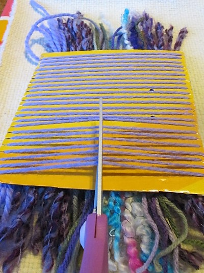 cutting the warp threads
