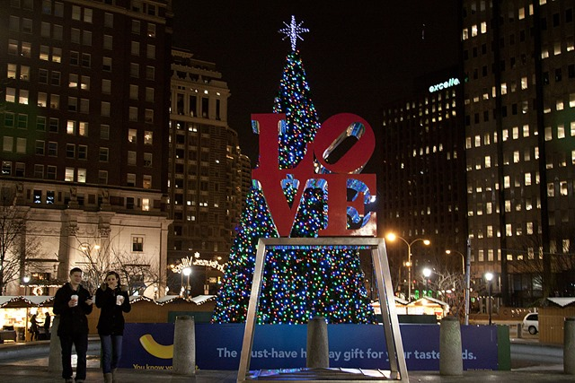 christmas village philadelphias love park houses a recreated traditional german market featuring more than 60 wooden booths selling traditional european