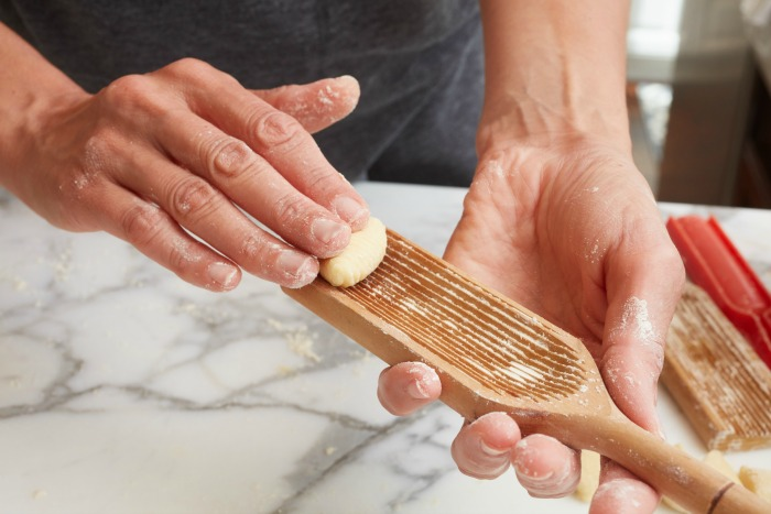 using a gnocchi paddle to form gnocchi