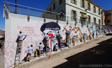 A multiple exposure photograph of artist Pure Evil putting  finishing touches to the mural he has painted in Valparaiso, Chile   Picture   -  David Bebber