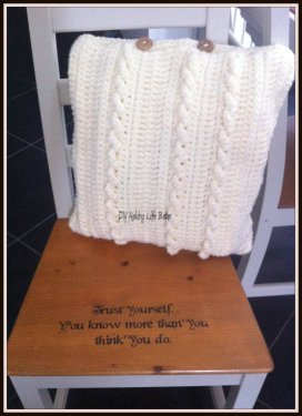 White crochet pillow with cables