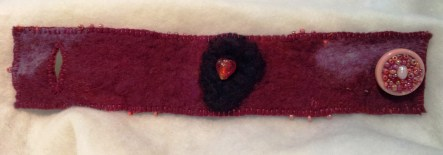 Cuff/bracelet made with hand-made felt, embroidery and beading.