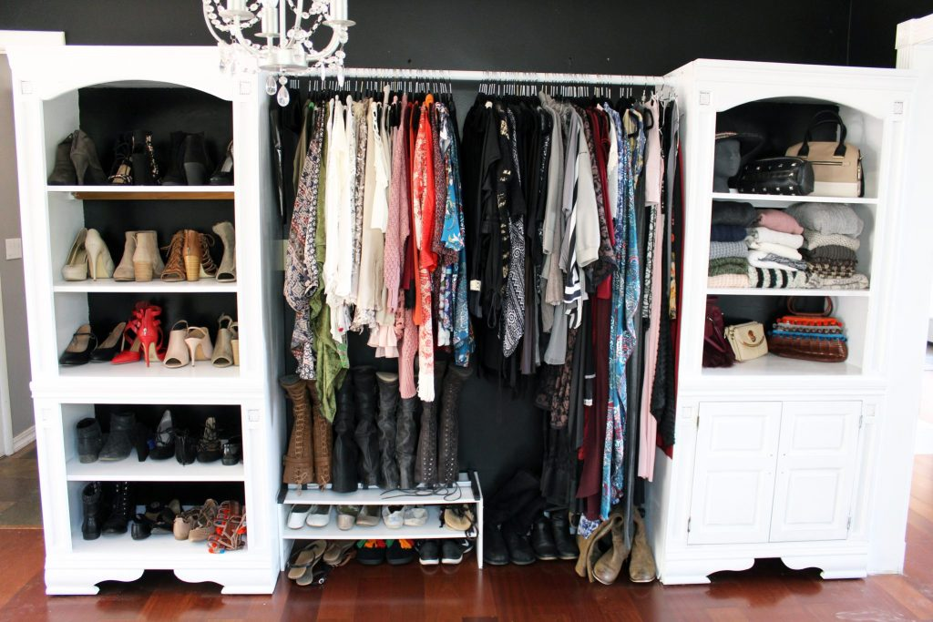 How to make a closet from an old bookcase. Click through for the easy full DIY tutorial