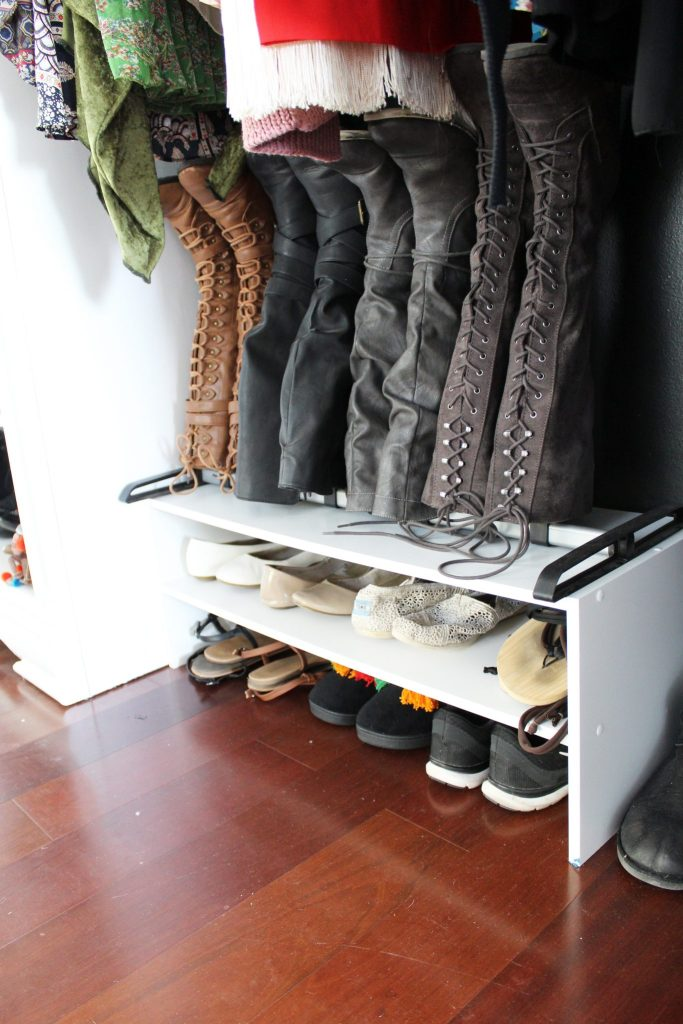 How to make a closet from an old bookcase. Click through for the full tutorial and make your own DIY closet!