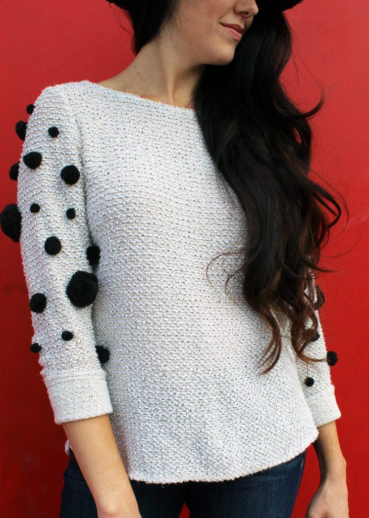 How to make an easy pom pom sweater . A clothing refashion idea