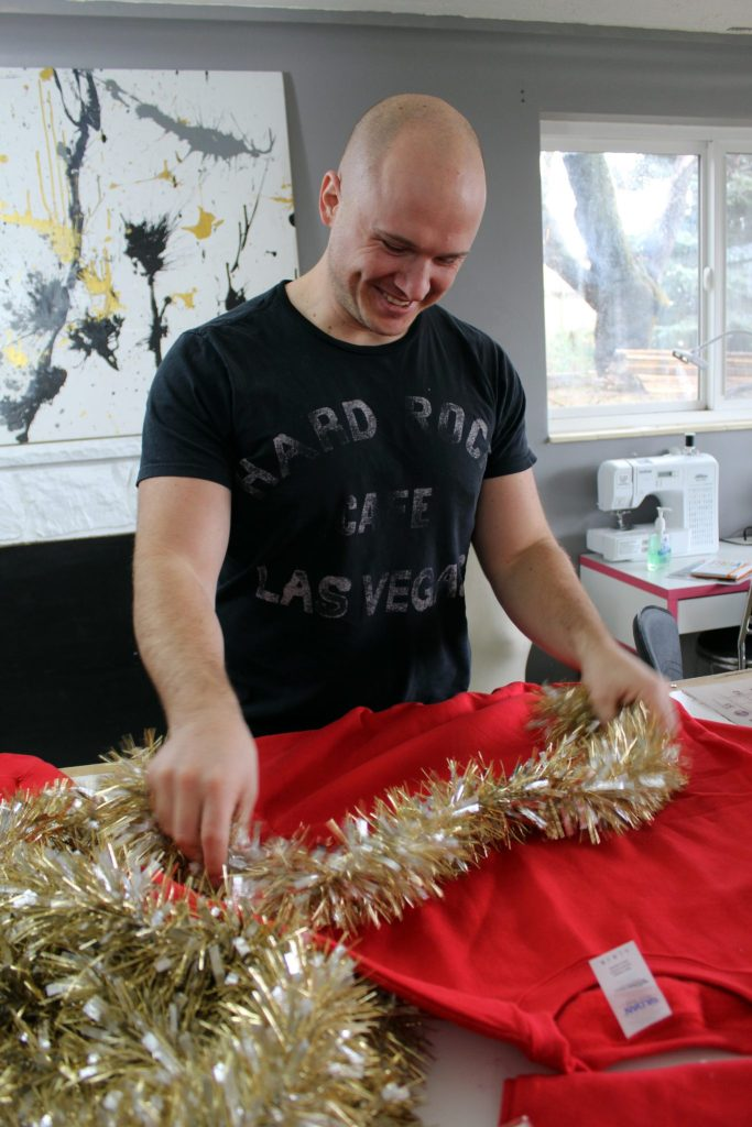 How to make an easy diy ugly Christmas Sweater from Christmas decorations