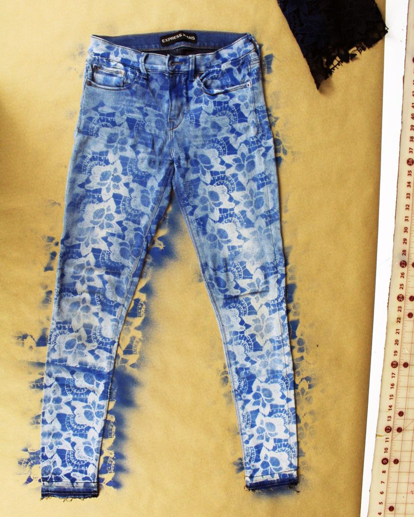 Easy DIY upcycle jeans refashion tutorial. Use lace and paint to create a stencil