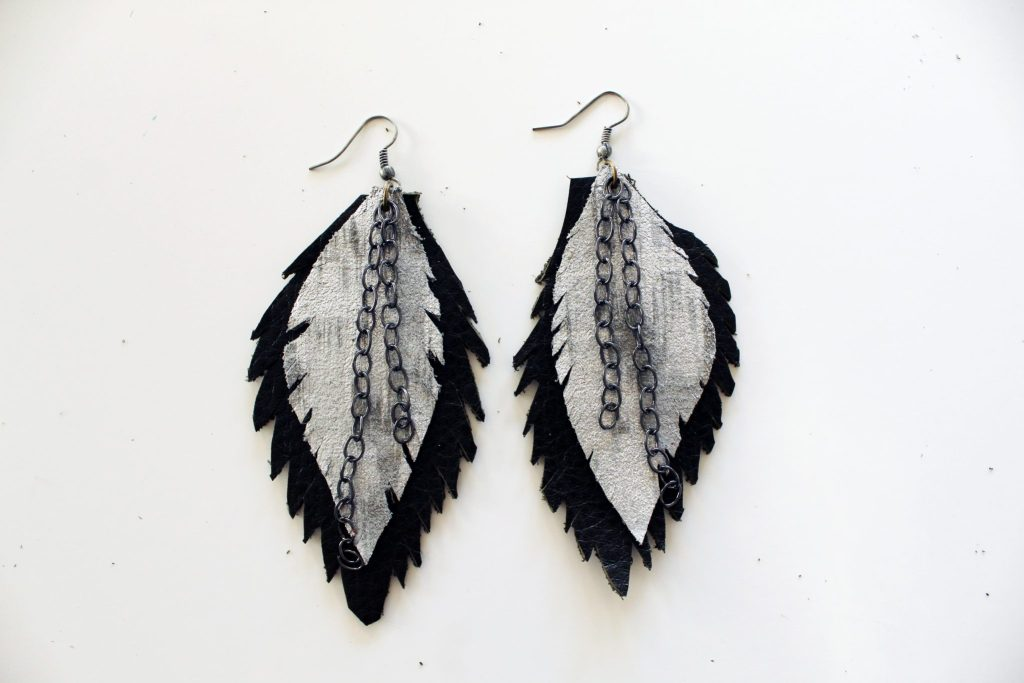 Make your own easy leather feather earrings with this DIY