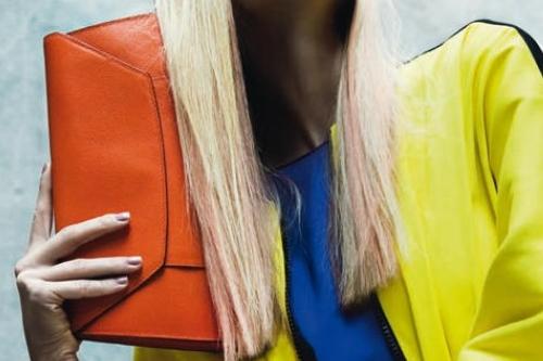 neon coat with orange clutch