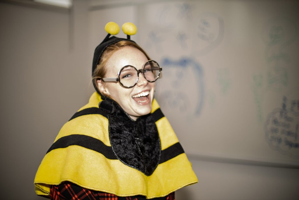 A picture of Brittany German in a bee costume.