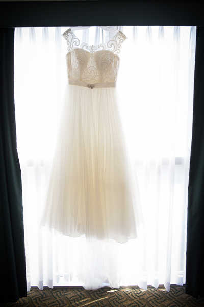 Wedding dress hangs in the window of the Mendenhall Inn